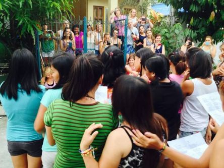 Filipino sisters singing a song about friendship to us our last night together. (Photo credit: Kenny Sacht)